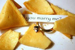 fortune cookie with engagement ring